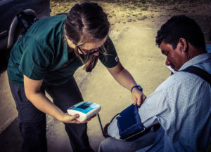Student taking blood pressure